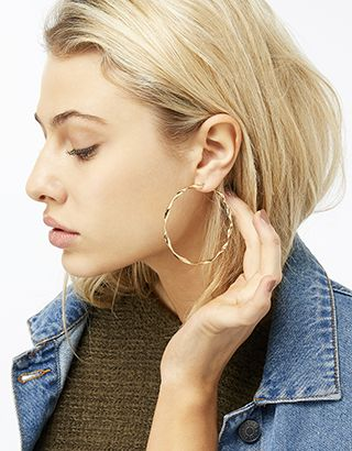 In a neatly twisted shape, our hoop earrings are a fresh take on the trend of the moment. Their large size guarantees a glamorous look no matter what you wea...