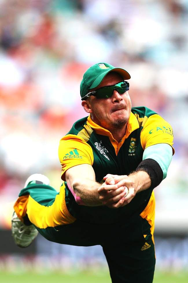 AUCKLAND, NEW ZEALAND - MARCH 07: Dale Steyn of South Africa takes a catch to dismiss Ahmad Shahzad of Pakistan during the 2015 ICC Cricket World Cup match between South Africa and Pakistan at Eden Park on March 7, 2015 in Auckland, New Zealand.