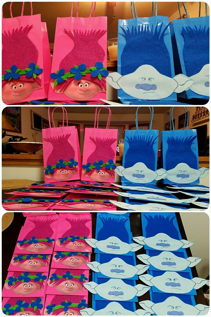 DIY Trolls Poppy & Branch gift party bags.   Learn how to make it: https://youtu.be/iezmSycxSV4  Hair made with felt cloth. Printed Poppy's face bc it was too difficult to sketch out free hand like Branch. Trolls Birthday theme Party favors bags Felt fabric Trolls Party