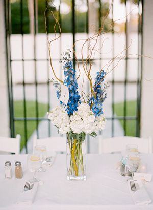 This #blue and white tall #centerpiece offers a modern & simple look with a splash of color. #wedding