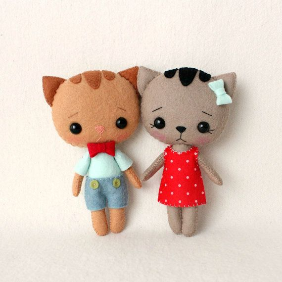 I'm super fond of these sweet little felt kitties. I want to tuck one in my pocket and go on an adventure!