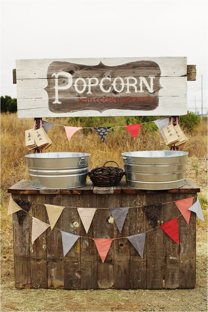 For a fun snack at the wedding reception, this DIY popcorn stand is a great choice.