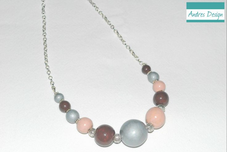 Painted wooden bead necklace in pastel colors, with silver metallic accessories