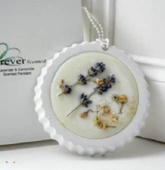 Lavender & Chamomile Scented Pendant  Tuck these botanical wax pendants into a drawer, or hang in a closet with the attached pearl cord, to spread the unexpected scent of Lavender & Chamomile.   Refined and innovative accessory perfuming small spaces  - Dried Lavender and Chamomile Buds - Keep away from heat - Sachet: 10cm H, 10cm H, 1cm thick - Handmade in the UK