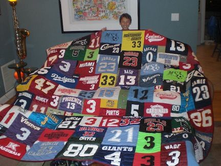 I want to do something like this!!  I have a mountain of the kiddies sports jerseys!!  ~Quilts Made From Jerseys~