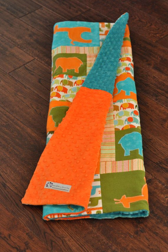 Orange, aqua and green animal applique shape baby quilt. Modern and vibrant. Great in an orange nursery.