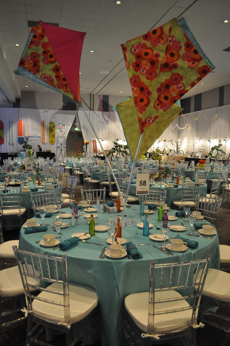 Beautiful fabric kite centerpieces  made of fabric and attached to a polished lucite base