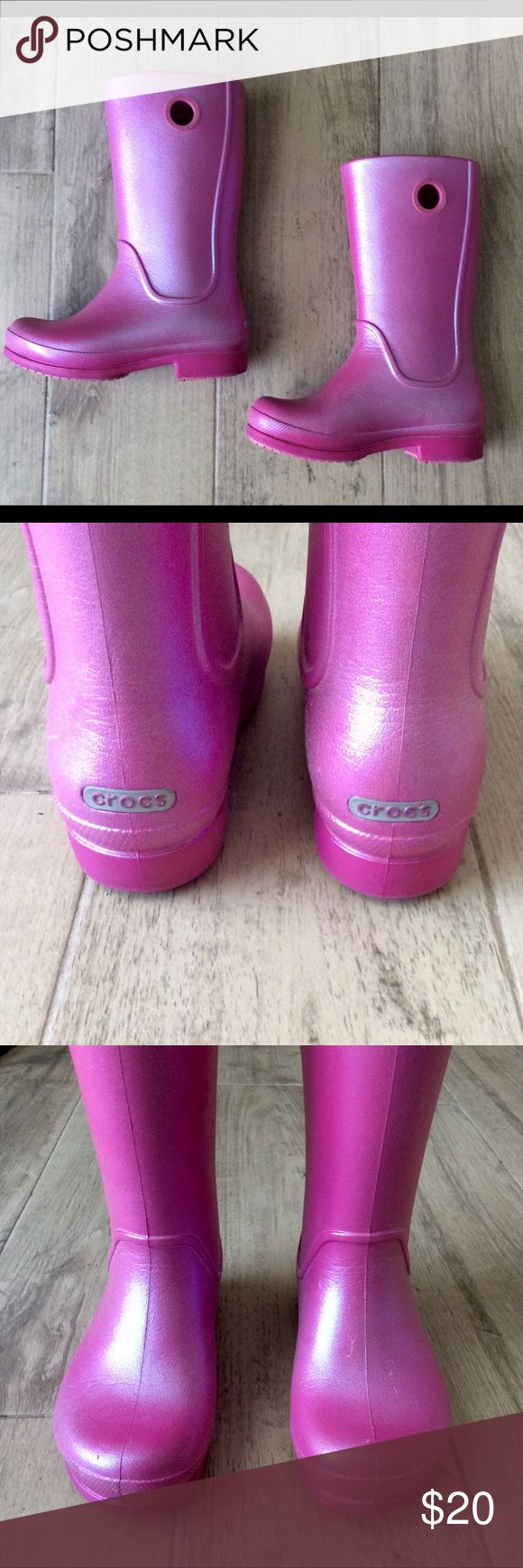 CROCS ☔️Little Girl's Rain Boots☔️ Very cute and comfy Pink Iridescent Rain Boots! Barely worn. There is a tiny bit of wear as shown in pic 4. CROCS does not make this style any longer. CROCS Shoes Rain & Snow Boots