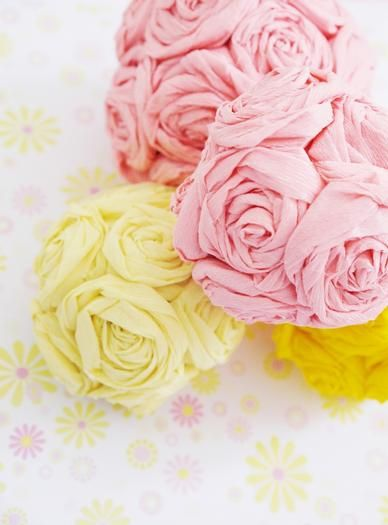 These tissue paper flowers are amazing!  Cheap Wedding Table Pieces (Source: hwtm.com)