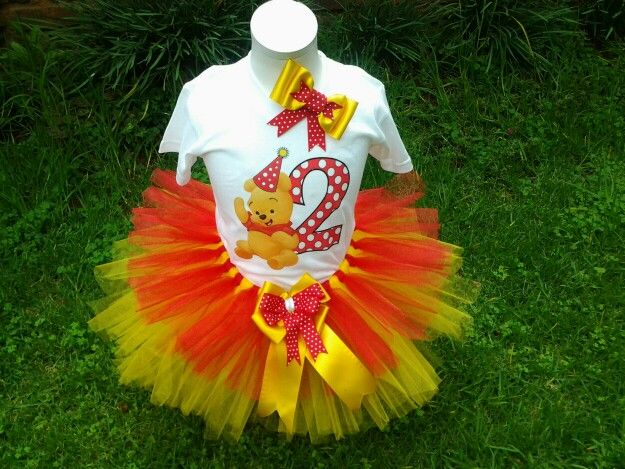 Multi layeted tutu skirt with large satin bow. Paired with a matching themed printed tshirt, and hair bow, on a clip.