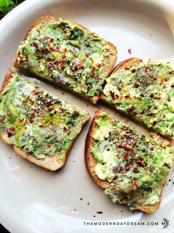 2 slices of Non-gmo Organic Bread 1/2 Avocado 1 tbsp EVOO spices (garlic powder, red pepper flakes, pepper, dash sea salt)  1. Mash avocado. Toast the bread. 2. Take the bread and smash the avocado mash on it. 3. Add the EVOO on the avo. Then add spices on top. 4. Careful if you put too much oil. 5. Eat, then contemplate making another one.  : )