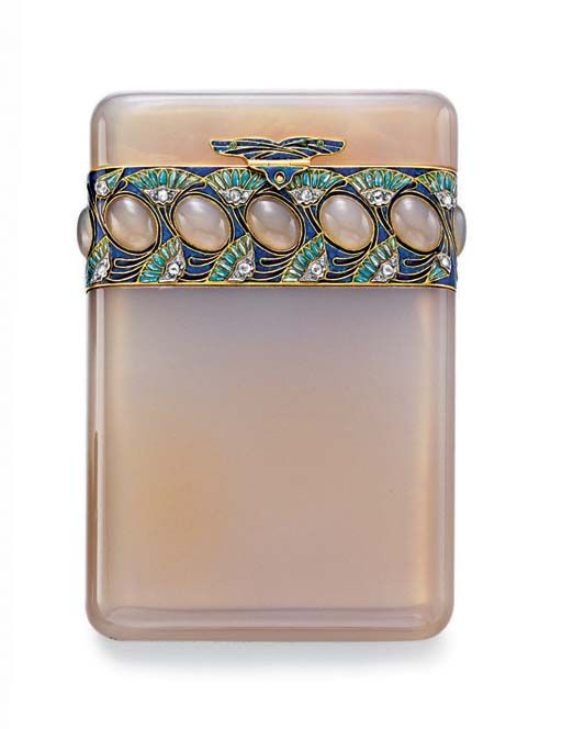 AN ART NOUVEAU AGATE AND ENAMEL CIGARETTE CASE, BY BOUCHERON  The rounded rectangular agate case, the lid enhanced by a series of oval-shaped cabochon agates, within a blue enamel frame, decorated with green enamel and rose-cut diamond papyrus flowers, with a green and blue enamel clasp and hinge, mounted in gold, circa 1910