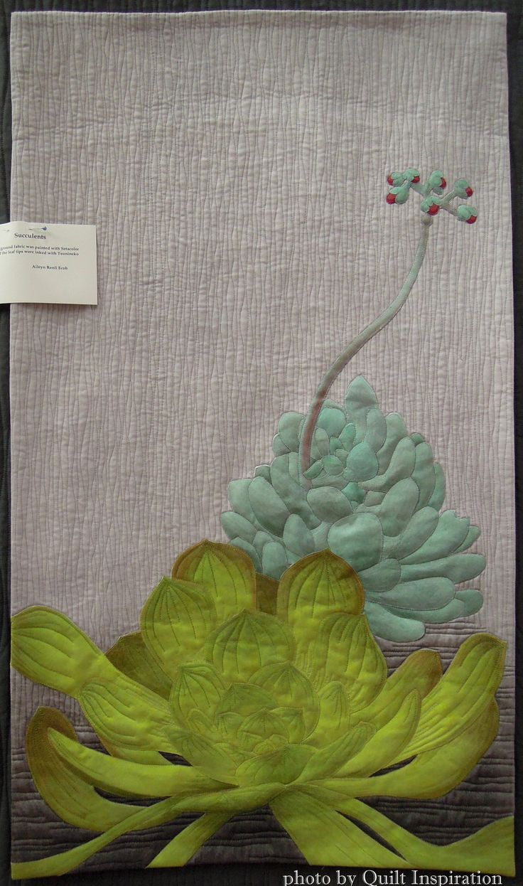 Succulents by Aileyn Renli Ecob. Featured Artist, 2015 DVQ show. Photo by Quilt Inspiration. The background fabric was painted with Setacolor paint; the leaf tips were inked with Tsukineko ink.