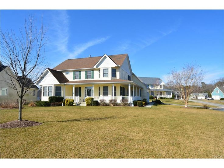 Craftsman, Single Family - Rehoboth Beach, DE This 4BR pondfront beauty features a great cul-de--sac location. Boasting 1st Floor master, eat-in kitchen, formal dining room, Great Room feat. gas fireplace w/access to rear deck & enclosed porch which overlooks the pond. The two car garage and full unfinished basement offer plenty of storage. Enjoy the indoor and outdoor pool, fitness area, playground, and community wide irrigation-never water your grass again!