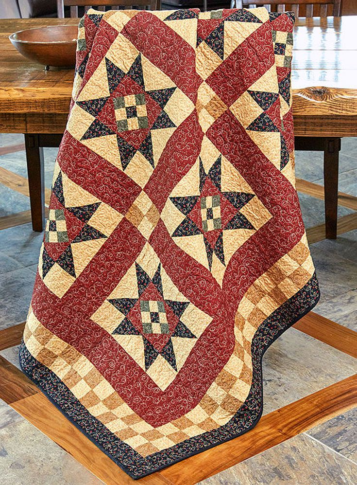 Several traditional elements are combined in this full-size quilt featuring Nine Patch quilt blocks, Variable Star quilt blocks, and Four Patch quilt blocks.