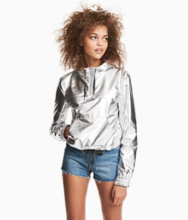 Silver-colored. H&M LOVES COACHELLA. Short nylon outdoor jacket with a shimmery metallic finish. Drawstring hood, zip at top, and yoke and kangaroo pocket