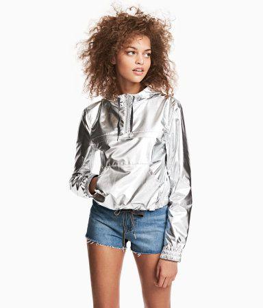 Silver-colored. H&M LOVES COACHELLA. Short nylon outdoor jacket with a shimmery metallic finish. Drawstring hood, zip at top, and yoke and kangaroo pocket