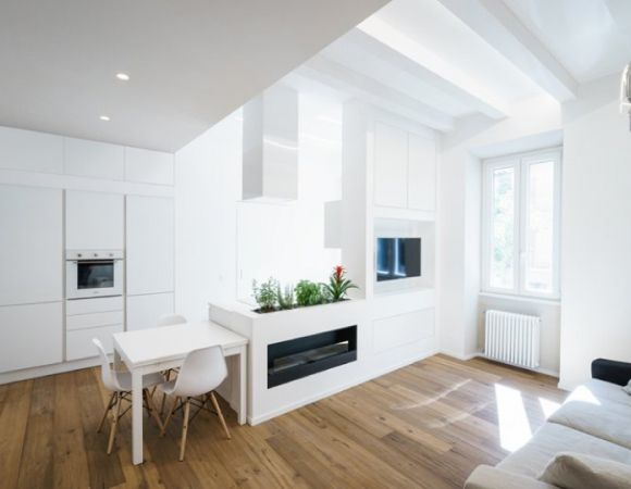 Modern Kitchen Design Idea With Multifunctional Wall In An All White Minimalist Apartment Rome Italy By Brain Factory