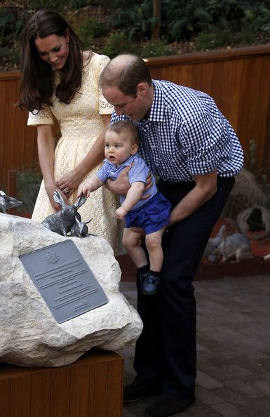 Catherine, Duchess of Cambridge and Prince William, Duke of Cambridge watch as their son Prince George of Cambridge reacts after they unveiled a plaque to commemorate their visit to the enclosure for the Australian animal called a Bilby, during a visit to Sydney's Taronga Zoo