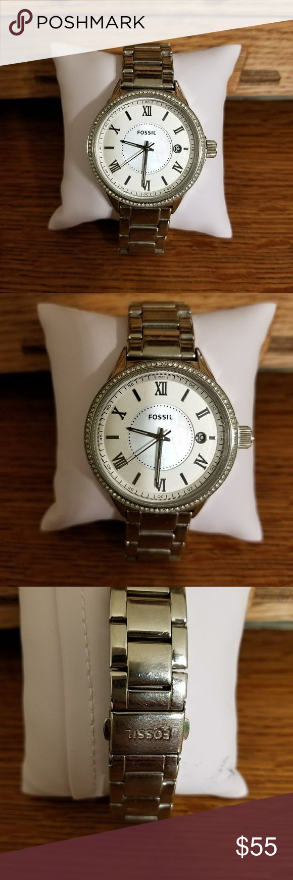 VGUC Women's Fossil watch VGUC Women's Fossil Watch. Mother of Pearl Face and date. Normal wear and tear.  No missing stones. Band is adjustable. Runs perfect.MSRP $125. Fossil Accessories Watches