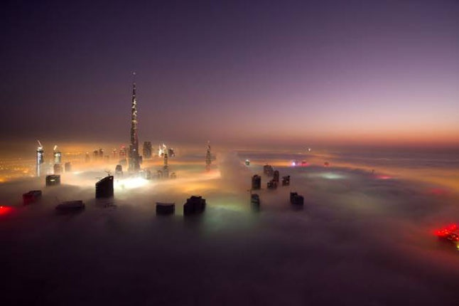The upper heights of Dubai's skyline as seen through clouds...I'd like to go there.