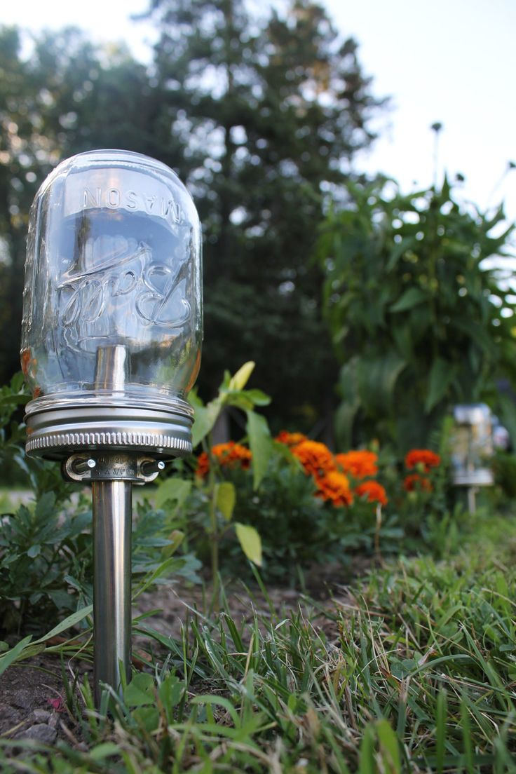 Solar Powered Mason Jar Lights - Eco Friendly Mason Jar Outdoor Path Light- Single Stainless Steel Accent - UpCycled BootsNGus Lamp Design. $15.00, via Etsy.
