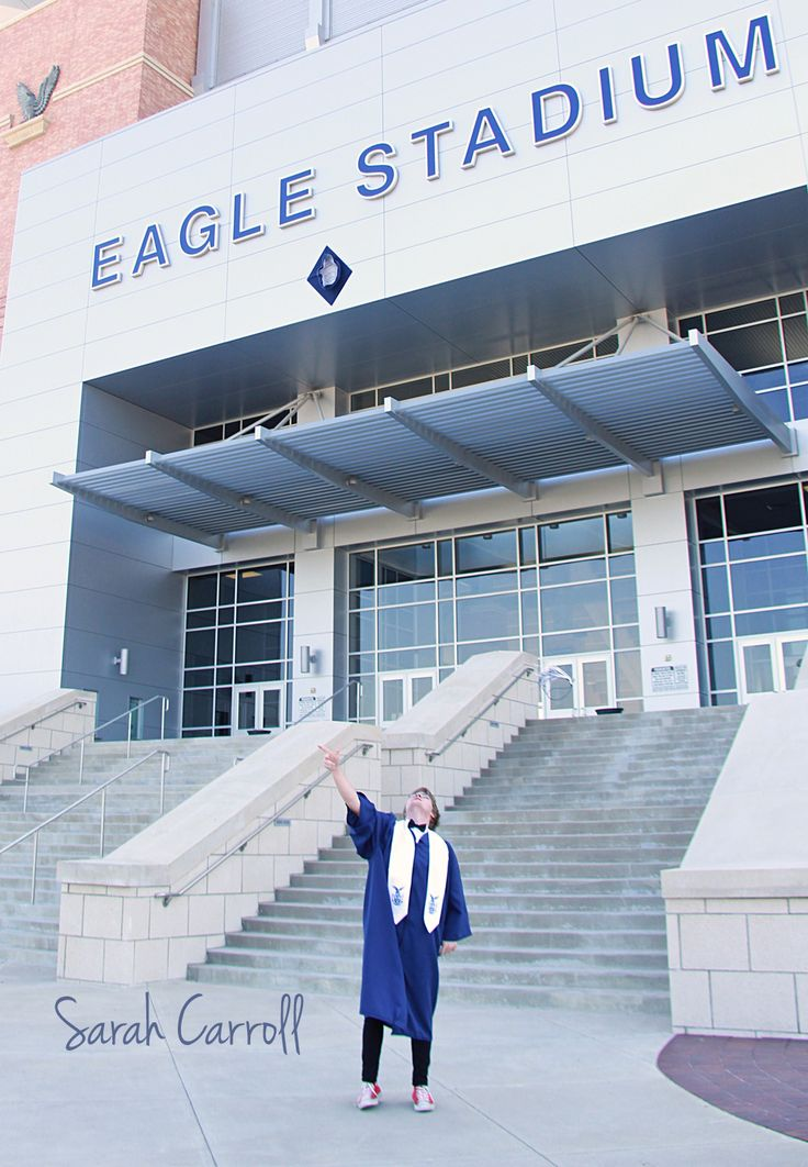 Senior boy throwing cap in the air in front of football stadium - cap and gown senior photos pictures - Allen Eagles - eagle stadium