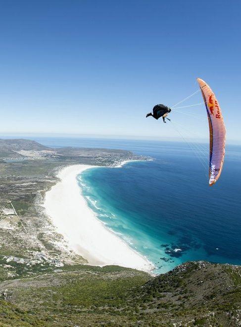 Cape crusaders Paraglider Marvin Ogger descends towards Cape Town, South Africa. Image: Kolesky https://www.facebook.com/marvinogger #paragliding #marvinogger