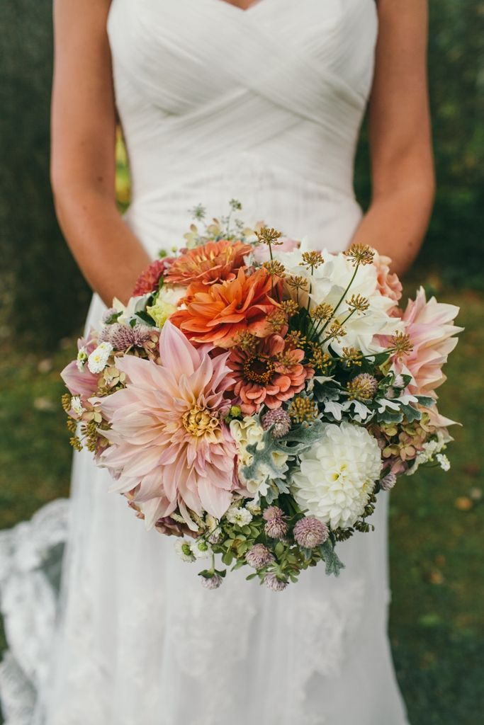 Cool mix. September bridal bouquet featuring dahlias and zinnias.  Flowers by Love 'n Fresh Flowers; Photo by Shannon Collins.