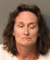 """The Riverside woman accused of arson, murder and elder abuse in the deaths of her parents is scheduled to be arraigned Thursday in Superior Court in Riverside."""