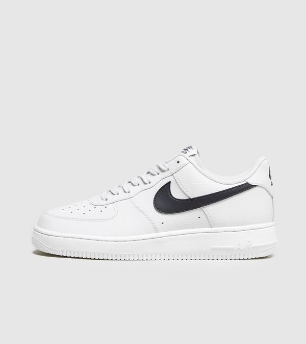 wholesale dealer c64a7 ae23c Nike Air Force 1. features black Swoosh branding to the sidewalls.  Underfoot, the pair s white midsole is engineered with Nike Air cushioning   men  shoes ...