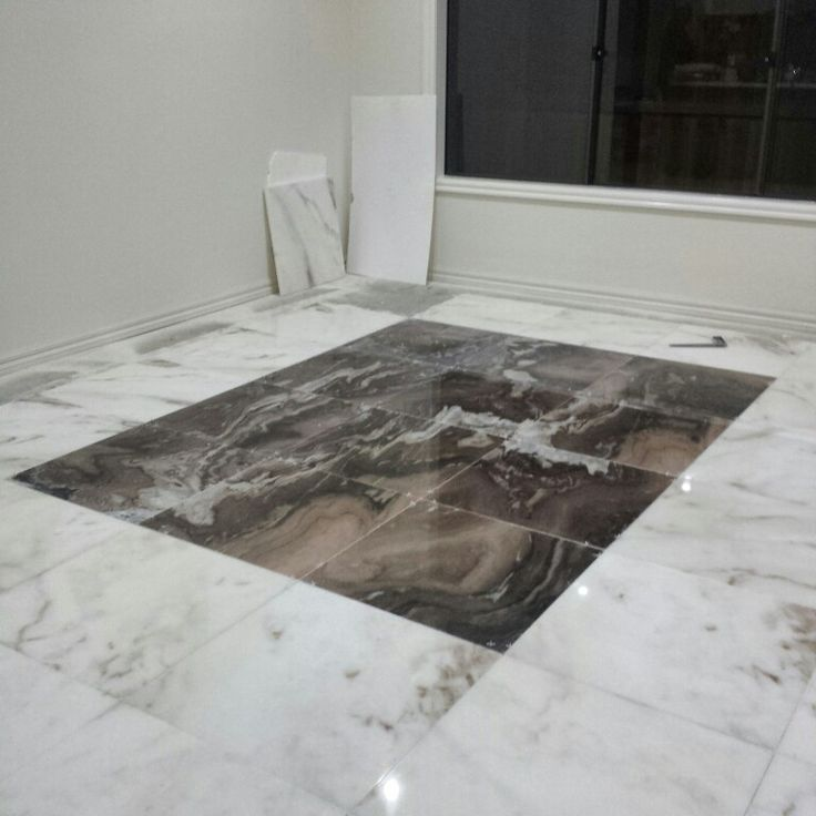 Marble bookmatched feature floor tiles