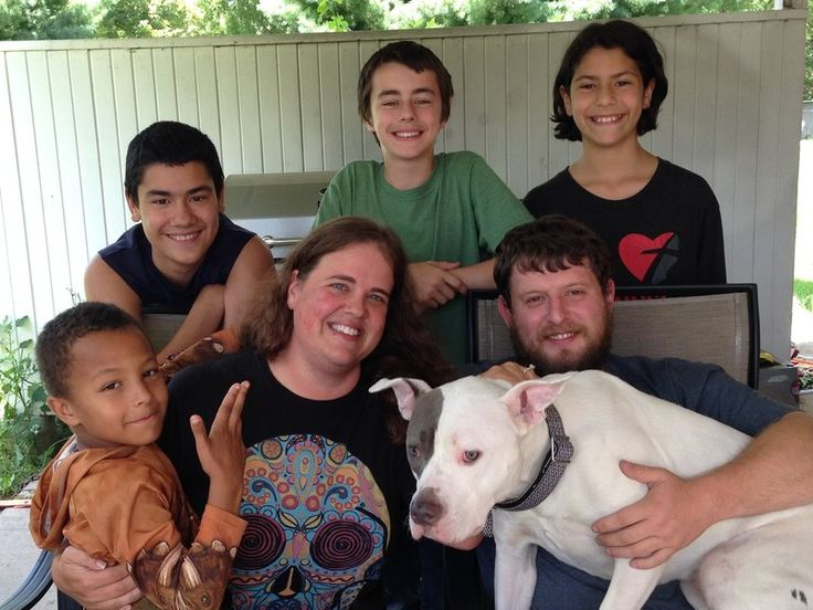 Whitney Gossett (seated, center) sits with her children (clockwise) Jeremiah, 7, Andrew, 12, Patrick, 13, and Bella, 10 — along with her fiance Brad Burtcher.