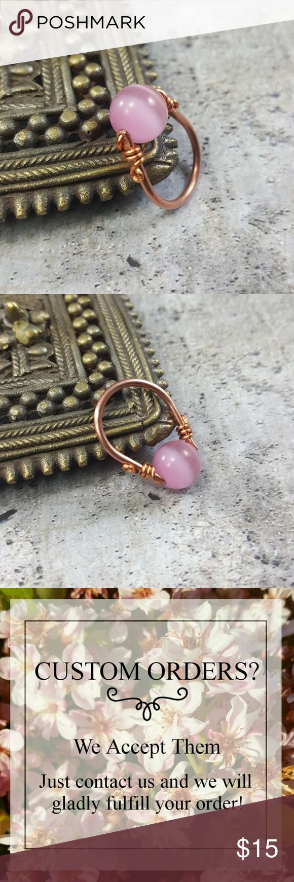 Pink Glass Cats Eye Ring Copper Wire Wrap Handmade A beautiful pink glass cats eye ring made with handmade copper wire wrapping.  • Pink glass cats eye bead 10mm. • Rings made to order ANY SIZE. • Also available in Sterling Silver or Gold color wire. • Comes in a jewlery gift box. • Perfect for gifts!🎁  ❤️Visit my website www.DGwiring.com❤️ DGwiring Jewelry Rings