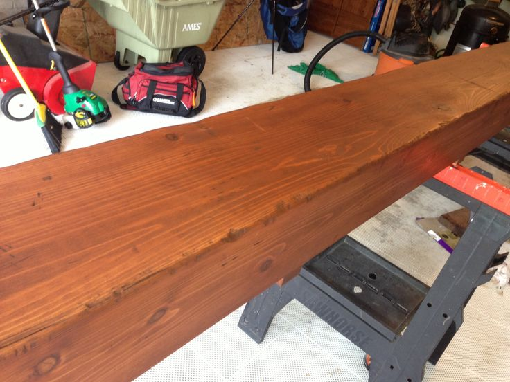 After distressing and staining the beam.