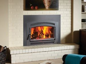 Large Flush Wood Hybrid-Fyre Insert with Single Arched Door by Fireplace Xtrordinair. Available at Rich's for the Home http://www.richshome.com/