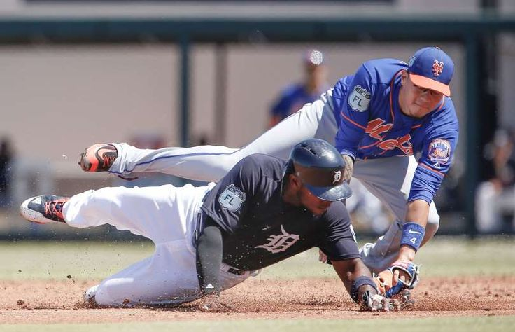 TAGGED IN TIME:    Justin Upton of the Detroit Tigers, bottom, gets tagged out trying to steal second by Wilmer Flores of the New York Mets at Joker Marchant Stadium in Lakeland, Fla., on March 20. The Tigers won 5-1.