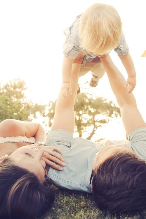Happy family love family spring outdoors happy baby mom smiling dad