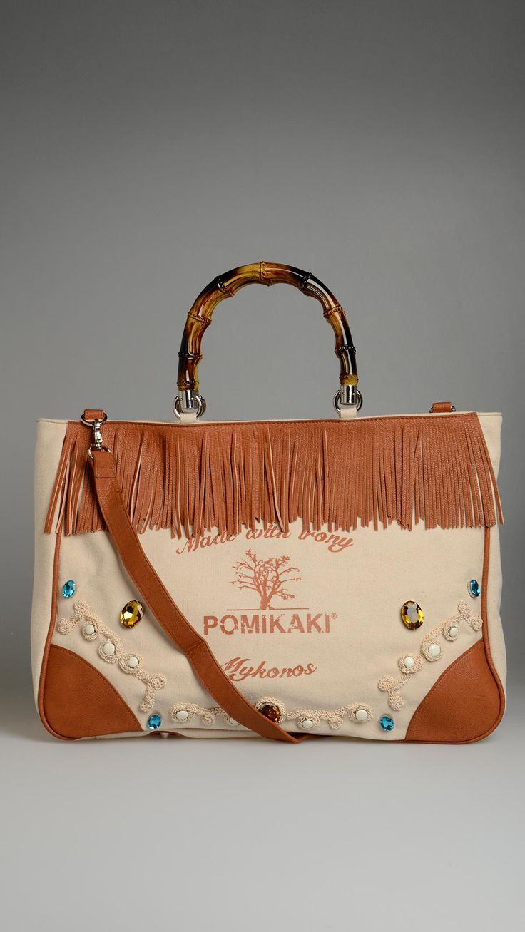 Pomikaki Brigitte brown fringes bag, zip closure, two inside pockets, inside pochette, round rigid handles, removable shoulder strap, eco-leather contrast fringes and patch, gems and embroidery detail, 17.16 x 13.45 x 6.43  inch - 44x34.5x 16.5 cm.