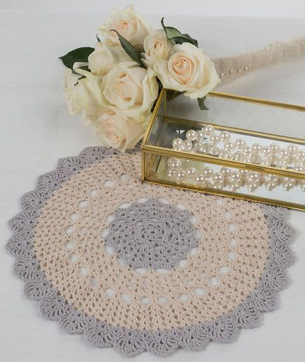 Scalloped Round Doily - This delicate beauty makes a setting feel a bit softer and more sophisticated. Its simple lines come to the perfect finish with a lacy scallop. Use it in the bedroom, living room or when serving food.