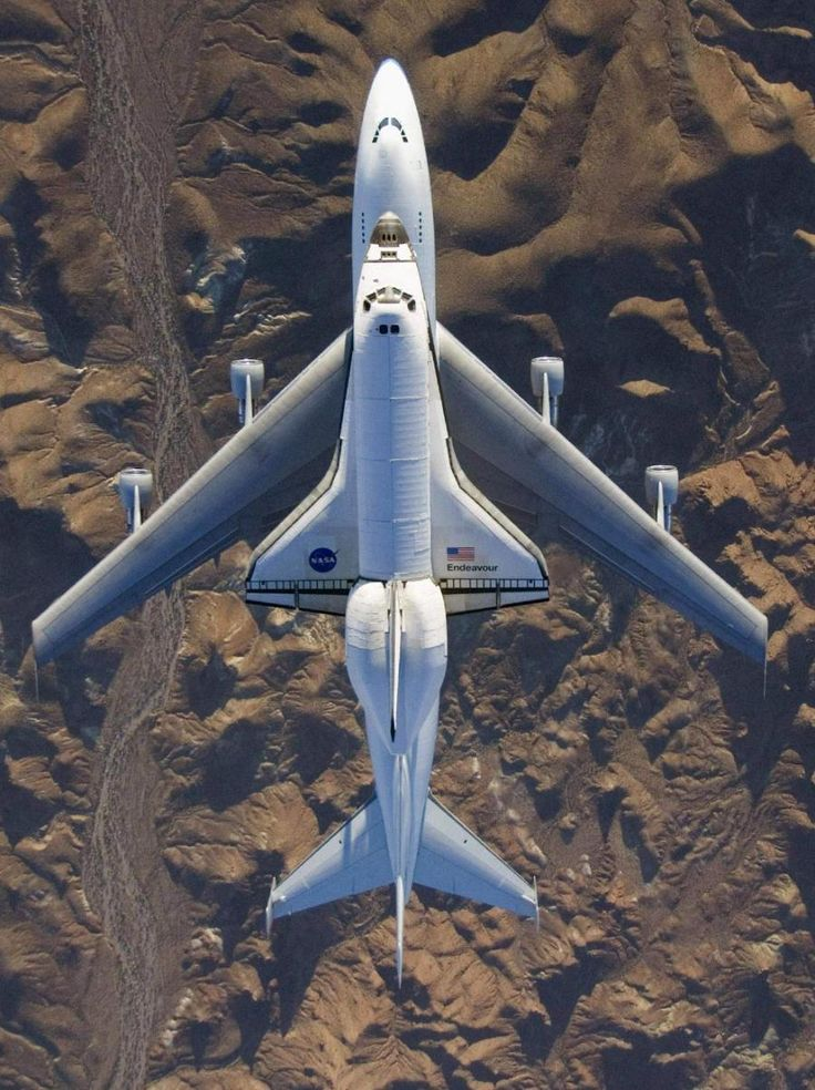 The space shuttle Endeavour, mounted atop its modified Boeing 747 carrier aircraft, flies over California's Mojave Desert