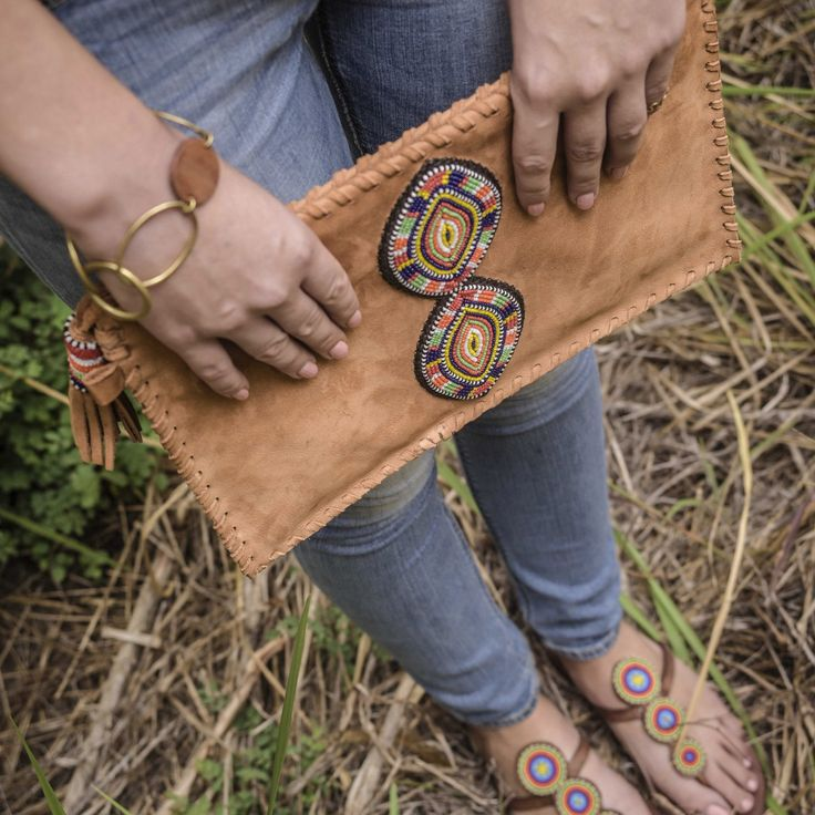 Rocking our tembo masai clutch bag in style