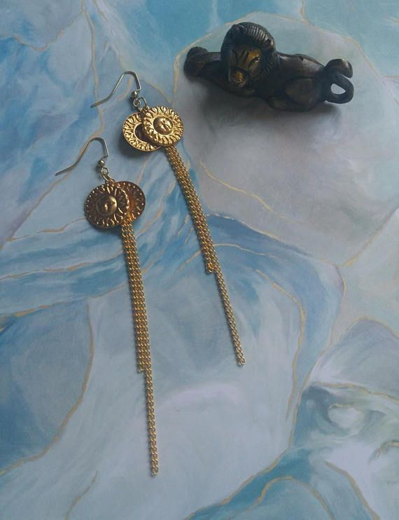 SUNNY DAYS golden charm and chain shoulder duster earrings