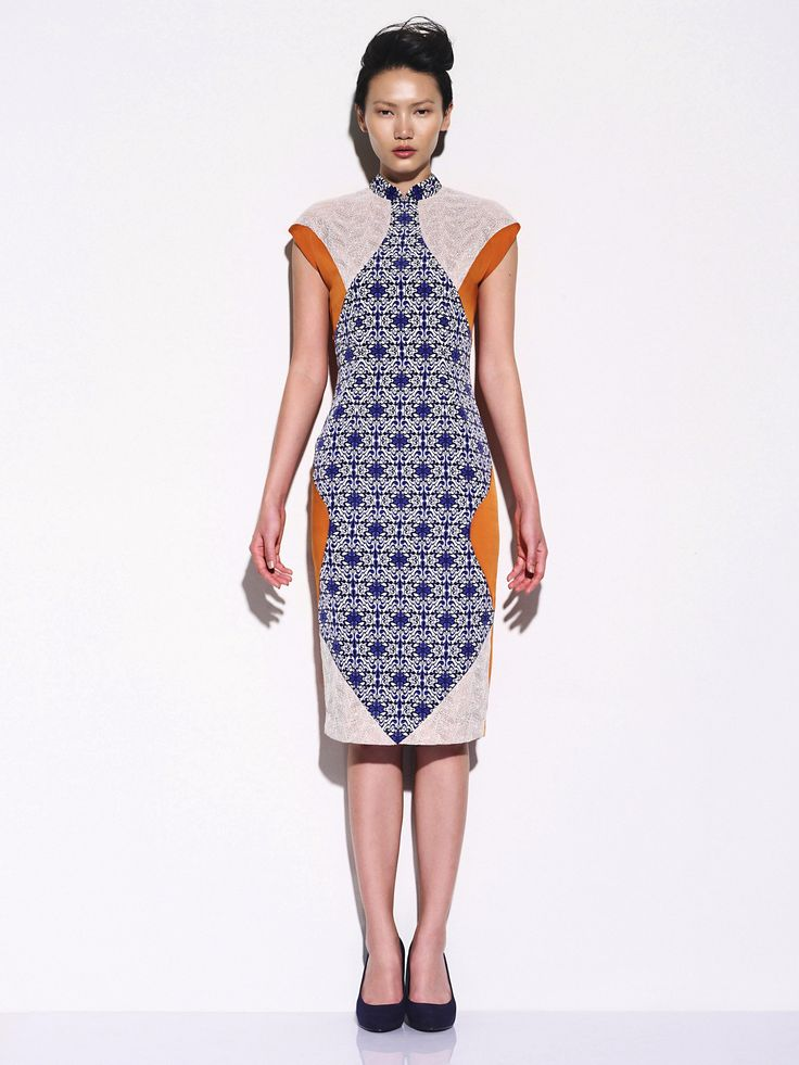 Ong Shunmugam's modern color clock cheongsam - i love the orange/blue combo.