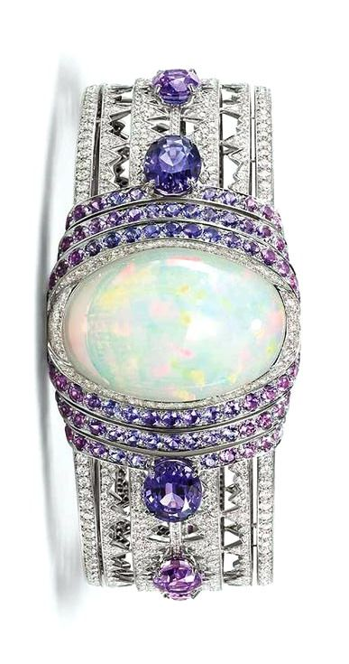 bracelet in white gold set with a 39.05ct cabochon-cut white opal from Ethiopia, brilliant-cut diamonds, oval-cut violet sapphires from Ceylon and Madagascar and round violet sapphires, from the Lumieres d'Eau high jewellery collection.