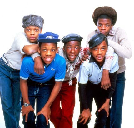 """New Edition, formed in Boston in 1978, is the group most credited for paving the way in popularity for the boy bands that followed. But it's the early-'80s amalgamation of New Edition—Ronnie DeVoe, Bobby Brown, Ricky Bell, Michael Bivins, and Ralph Tresvant—that most music fans remember, because that's when they released all of their big hits, like """"Candy Girl,"""" """"Is This the End?,"""" """"A Little Bit of Love,"""" and """"With You All the Way."""""""