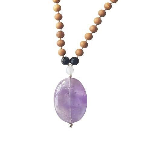 The Zen Mama Mala encourages spiritual awareness, helping to connect the mind, body & soul. It is the perfect Mama Mala for deepening your meditation practice & connecting with your inner self. Amethyst activates both the crown & third eye chakra, enhancing your intuition & heightening spiritual awareness & introspection. Blue Lace Agate is a calming stone that brings a feeling of peace & tranquillity while Black Onyx increases concentration & facilitates the release of past resentments.