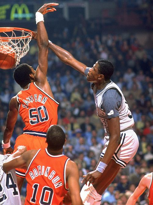 Patrick Ewing dunks on Ralph Sampson during a 1982...