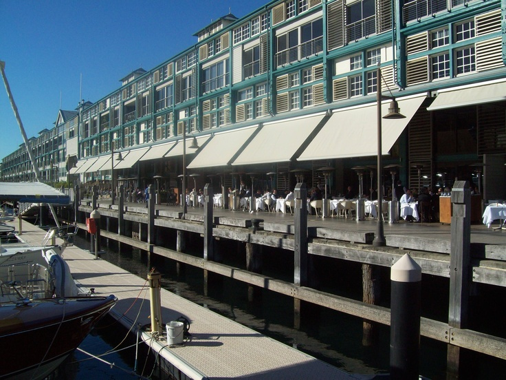 Modern Retractable Blinds and Awnings. Issey installed mototorised retractable awnings at the cafes at Woolloomooloo in Sydney to protect the patrons from the low sun.