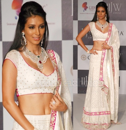 at Indian Jewelry Week, 2013, delicately embellished white lehenga with the overall look of pearls and gems was a true winner! An elegant look for any woman! A beautiful blouse for any saree too!